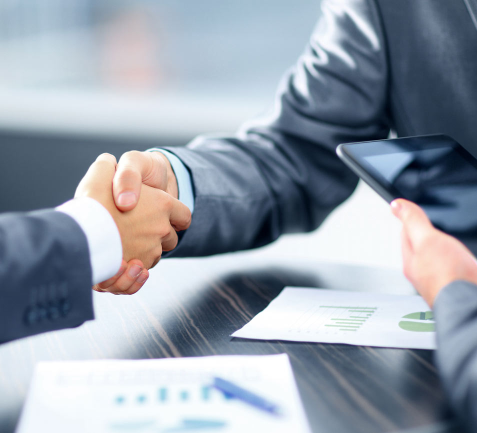 Business Professionals shaking hands. | Hilton Global Associates Investigative Due Diligence